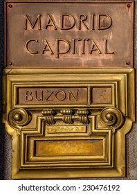 Copper and golden  colored Post office box in Madrid in Spain