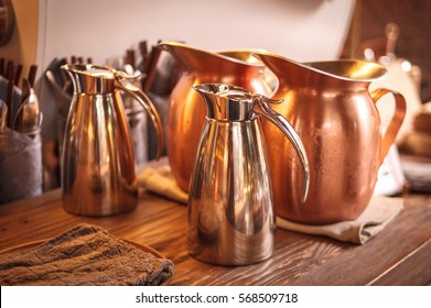 Copper jars on the wooden table