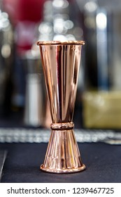 Copper jigger for cocktails is on the bar.