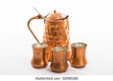 Copper jug and copper wine cups