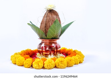 Copper Kalash with coconut , leaf and floral decoration on a white background. essential in hindu puja.