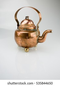 Copper kettle isolated on white background.