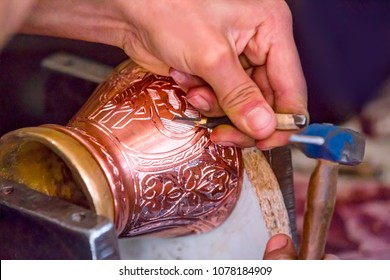 Copper master, Hands detail of craftsman at work - Gaziantep,Turkey