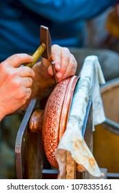 Copper master, Hands detail of craftsman at work - Gaziantep,Turkey
