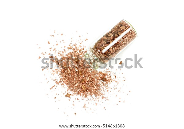 copper metal shavings in a glass flask on a white background