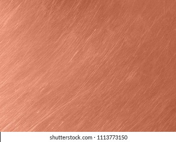 The copper metal texture with circular scratches.