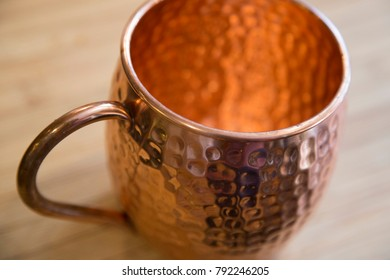 Copper moscow mule cup mug close up angle shot background texture cocktail