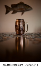 Copper Moscow Mule Mug Reflected on a Table