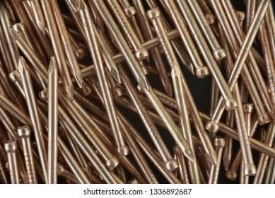 A lot of Copper nail. Macro photo. Natural photo.