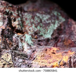 Copper ore closeup shot, orange, green and brown details