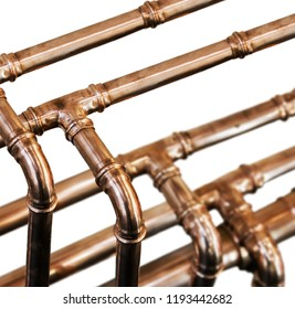 copper pipes and fittings for carrying out plumbing isolated on white background