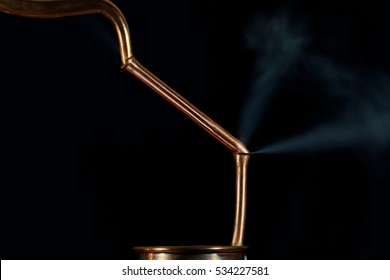 Copper pipes with a leak and steam.