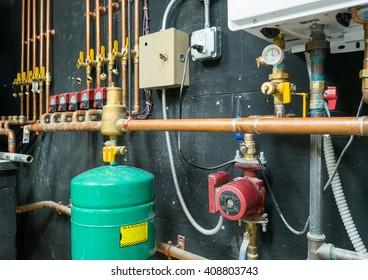 Copper pipes and valves with control unit mounted on the wall
