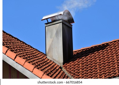 Copper plated Chimney at a tiled Roof