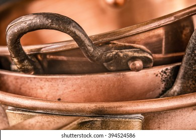 Copper pots and pans background close-up