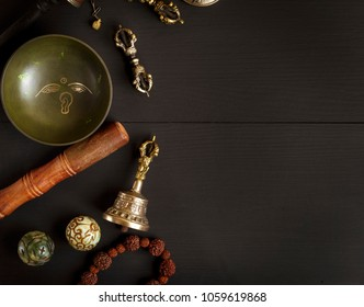 Copper singing bowl, prayer beads,  stone balls and other Tibetan religious objects for meditation , top view, empty space