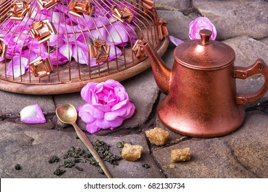 Copper stylish tea pot with tea rose