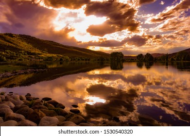 Copper sunset lighting reflecting off a Lake in Avon, CO.
