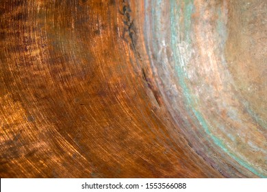 Copper surface of the inner wall of the copper pot. Green circles of copper oxidation. Copy space.