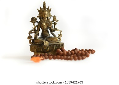 Copper Tara statue on a white background with Rudraksha mala