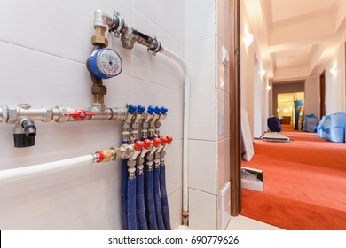 Copper valves, stainless ball valves, detector of water  and plastic pipes of central heating system and water pipes   in apartment during under renovation, remodeling and construction.