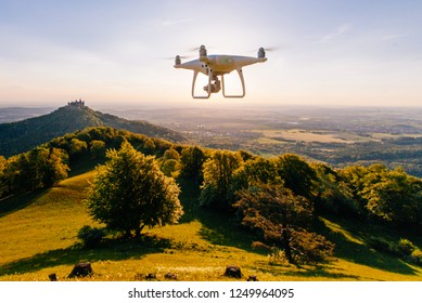 copter drone flying at sunset in hohenzollern castle area, Germany