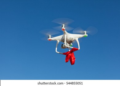 Copter with ribbon flying high in the sky