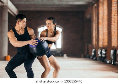 copuple performing exercises with fitnes ball. exercise ball. med ball.rehabilitation, strength training. copy space. close up photo