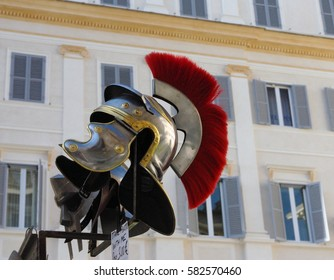 Copy of Ancient Helmet of Roman Legionnaire with copper accents and a red plume. Italy. Rome. Typical Roman souvenir.