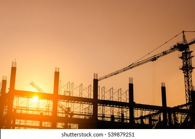 Copy space of building construction site on sunset sky background. Business and industrial concept. Vintage tone filter effect color style.