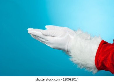 Copy space concept. Open palms of Santa. Blue background.