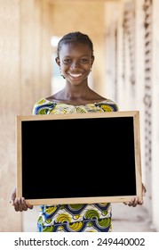 Copy Space: Gorgeous African Ethnicity Teenage School Girl Holding Blackboard (Schooling Education Symbol)