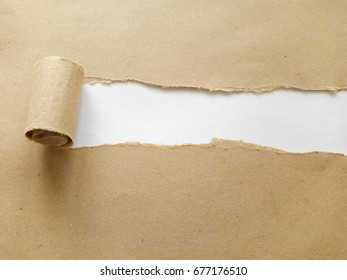 Copy space and greeting concept. Brown paper's envelope torn with copy space on white background. Selective focus.