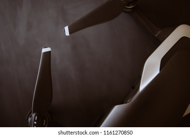 Copy space. Innovation photography concept. Mate color. A new black drone on a black table. The concept of using drones in life and industry. Close up drone Engines and blades macro Details.