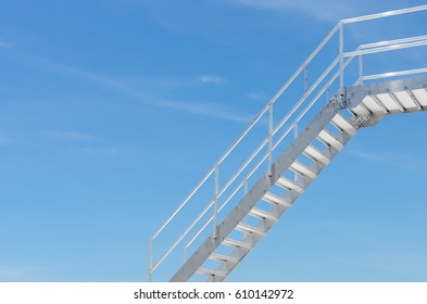 Copy space of iron stairs on blue sky and white clouds background. Business and attitude concept.