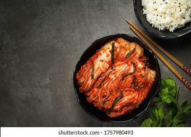 Copy space Korean food, Kimchi and rice in black bowl with chopstick.