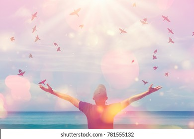 Copy space of man rise hand up on sunset sky at beach and island double exposure bird fly colorful bokeh abstract background. Freedom and travel adventure concept. Vintage tone color style.