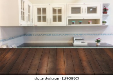 copy space on brown old wood shelf with blurry kitchen room background.