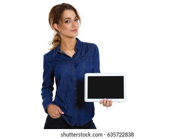 Copy space on her tablet. A cute young woman showing her digital tablet and smiling while standing on a white background