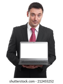 Copy space on monitor. Handsome young man holding a laptop over white background