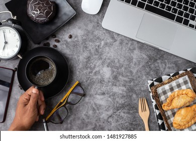 copy space on office desk with dessert and black coffee cup.