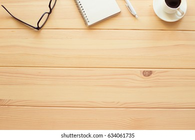 Copy space on wooden table with coffee and glasses