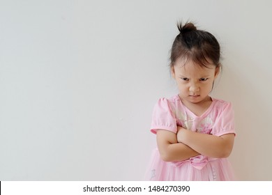 Copy space and portrait Asian girl 3 year old punished. Asia kid cross her arm and making angry face. Concept punish kid and time out limit, Rule and punishment, problem and handle, terrible two