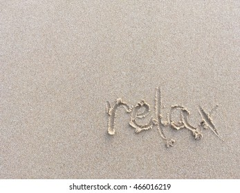 Copy space of relax words on sand beach texture background. Travel concept.
