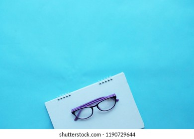 copy space Stethoscop and  glasses notbook on blue background. space for text