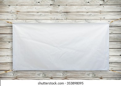 Copy space for text on disastrously white vinyl banner on wood background .Clipping path