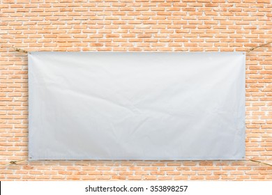 Copy space for text on disastrously white vinyl banner on brick background .Clipping path