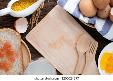 copy space for text on wooden cutting board and varieties breakfast, concept of  healthy food.