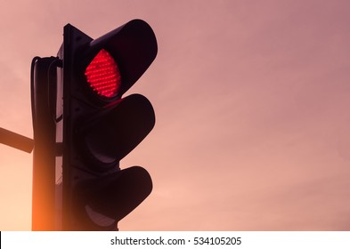 Copy space of traffic light on sunset sky background. Transportation and sign concept. Vintage tone filter effect color style.