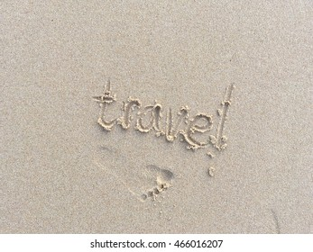 Copy space of travel words and foot print on sand beach texture background. Travel concept.